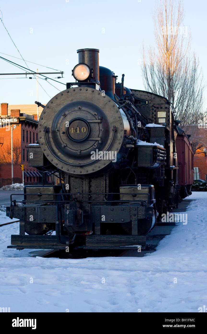 Boston & Maine Steam Locomotive #410 with headlamp on in snow. - Stock Image