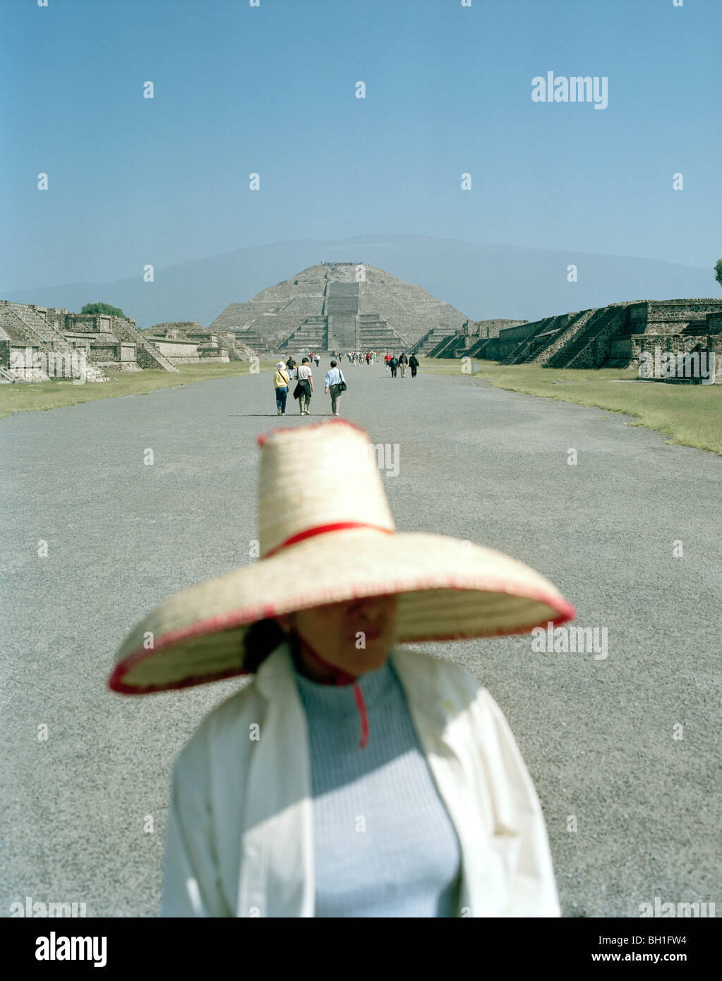 9737e3d713f33 Woman wearing a sombrero standing on the road in front of the moon palace