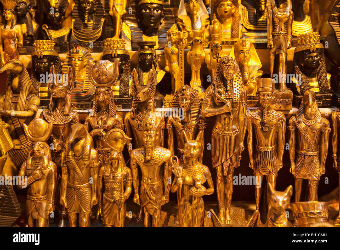 Shining statues of egyptian pharaos and gods, Bazaar Khan el-Khalili, Cairo, Egypt, Africa - Stock Image