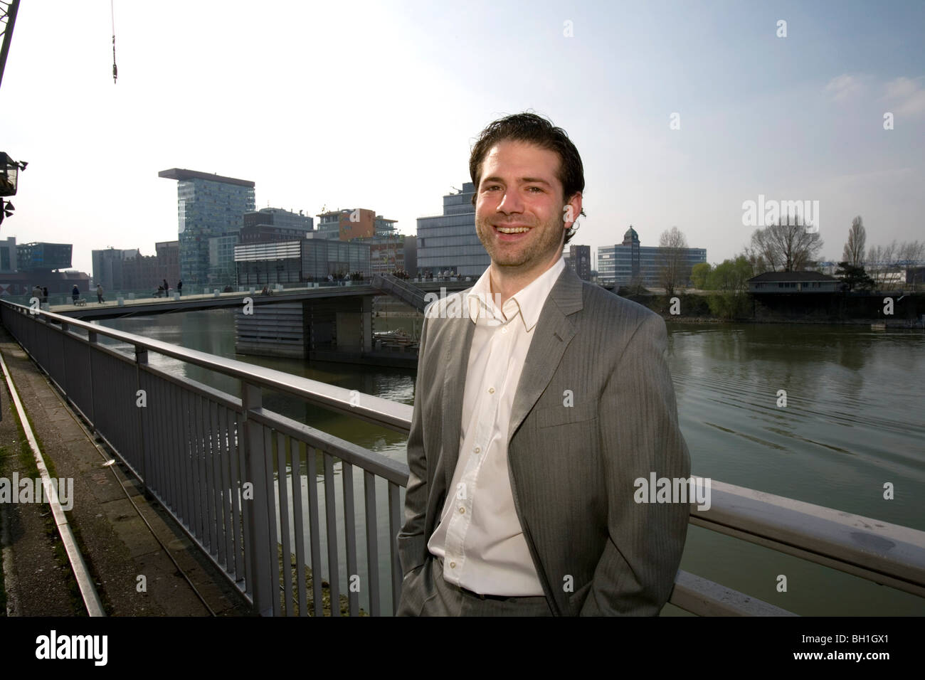 young buisness man in the district of media, new district of Duesseldorf, harbor, state capital of NRW, North-Rhine - Stock Image