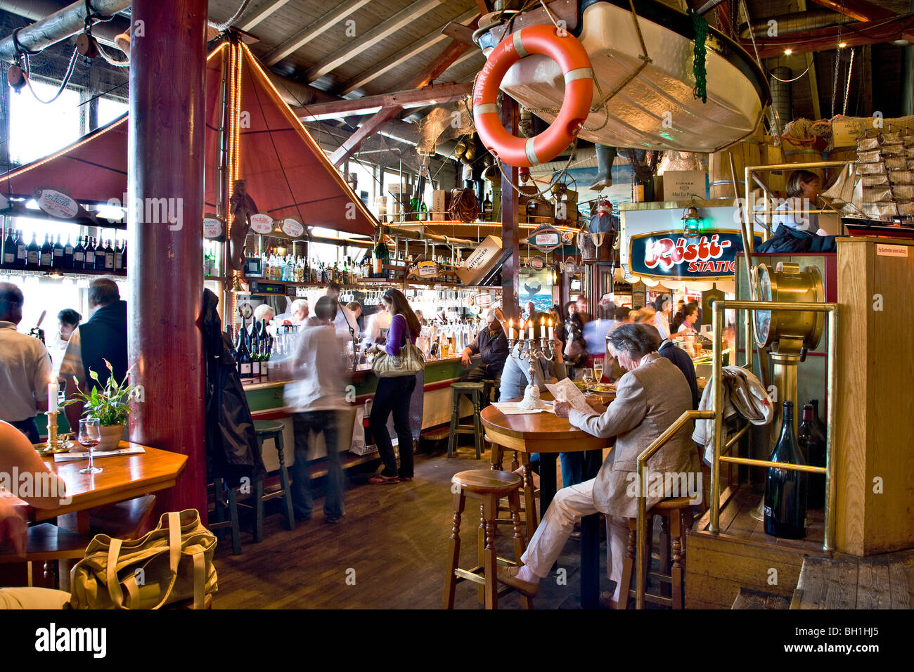Guests in a fish restaurnat, List, Sylt Island, Schleswig-Holstein, Germany - Stock Image