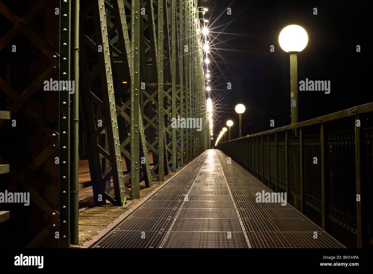 Deserted railway bridge and street lamp at night, Linz, Upper Austria, Austria - Stock Image