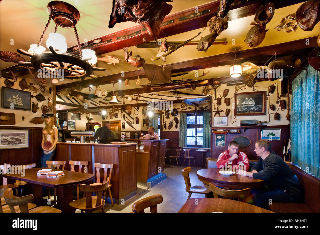 Guests in an old fishermens bar, Wyk, Foehr island, North Frisian Islands, Schleswig-Holstein, Germany - Stock Image