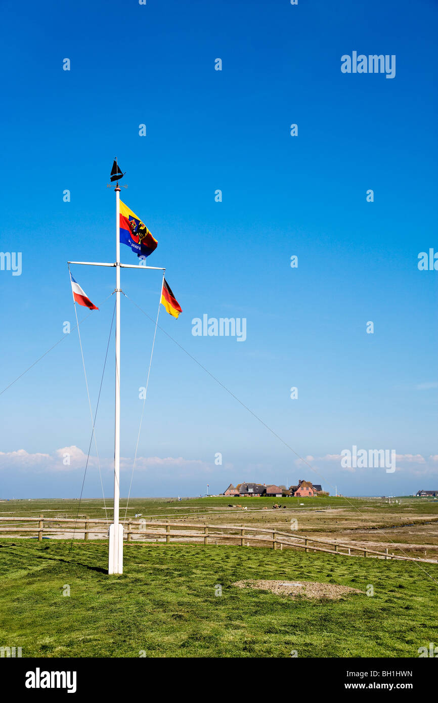 Flagpole at Hooge hallig, North Frisian Islands, Schleswig-Holstein, Germany Stock Photo