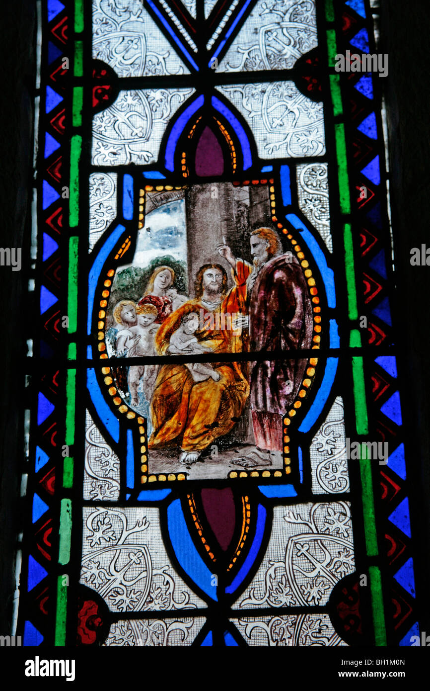 Detail from a stained glass window depicting 'Suffer the Little Children to Come Unto Me' - Stock Image