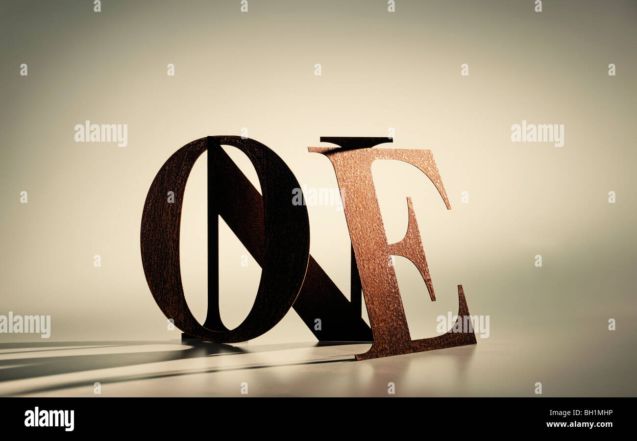 one in rusted steel letters - Stock Image