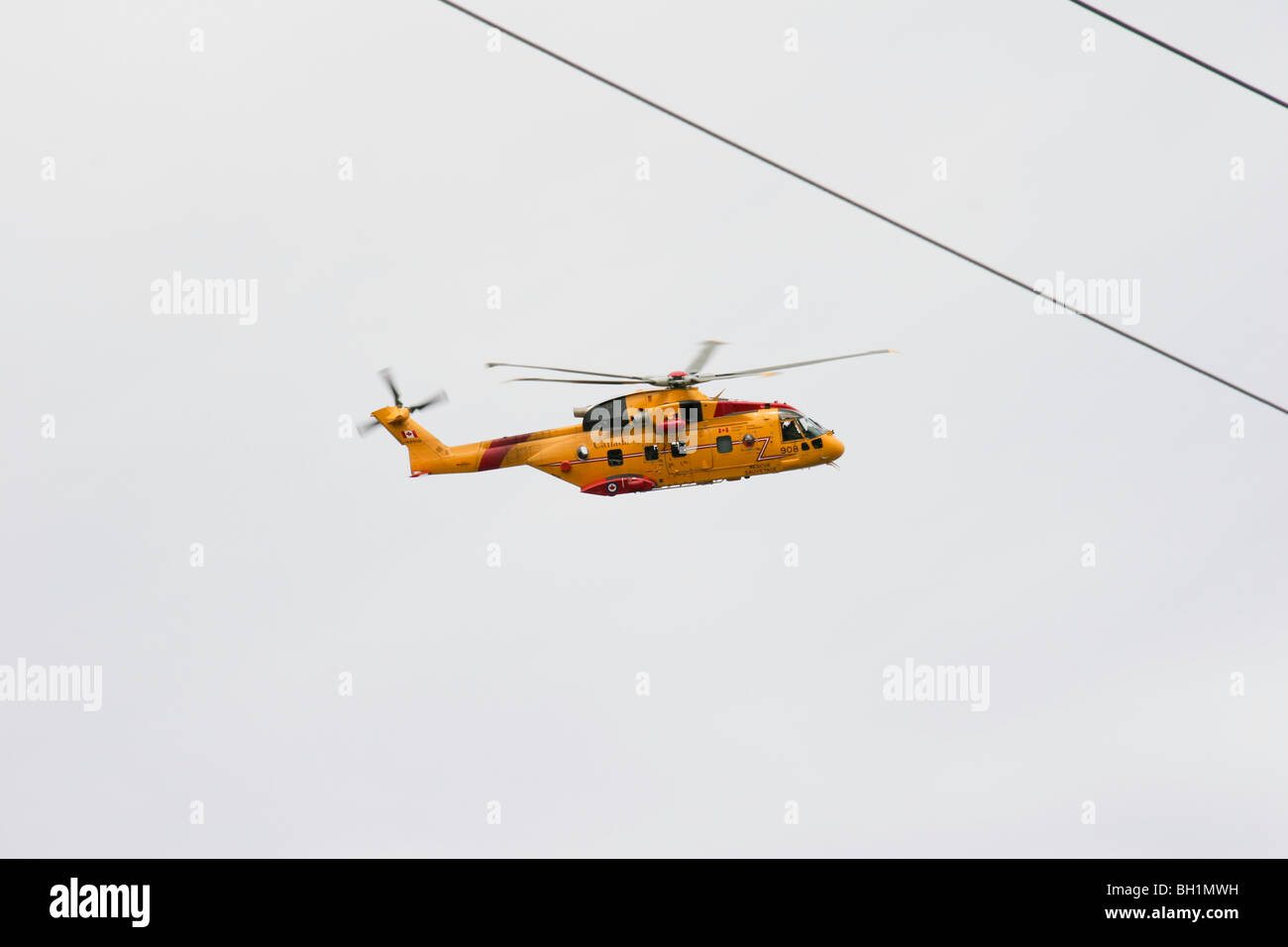 A Canadian Rescue Helicopter overflies the Ramea Islands of Newfoundland - Stock Image