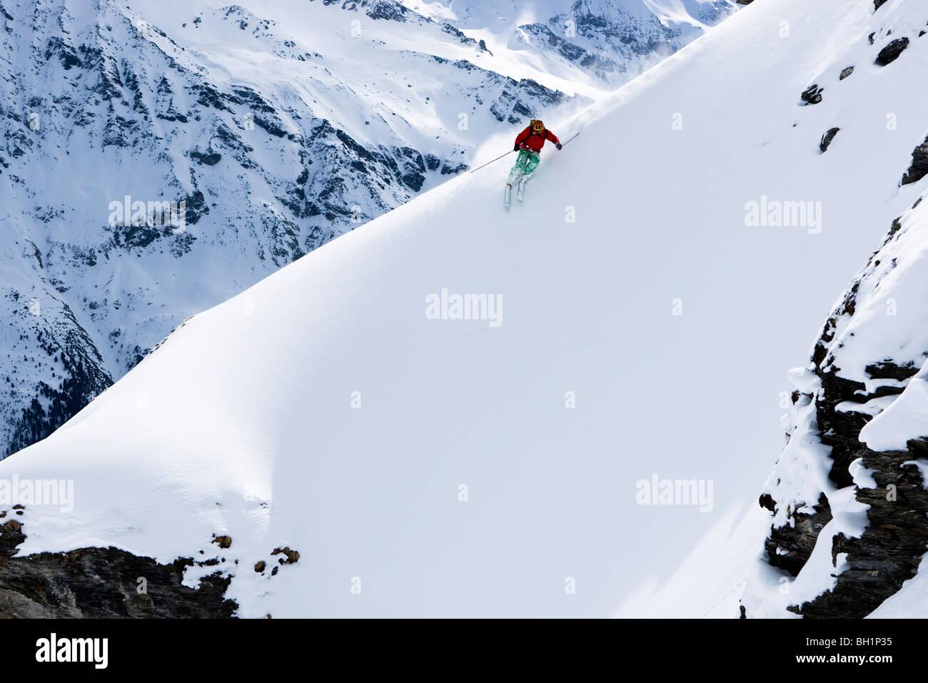 Domaine de Freeride, Zinal, A young man skiing in powder snow, canton Valais, Wallis, Switzerland, Alps, MR - Stock Image
