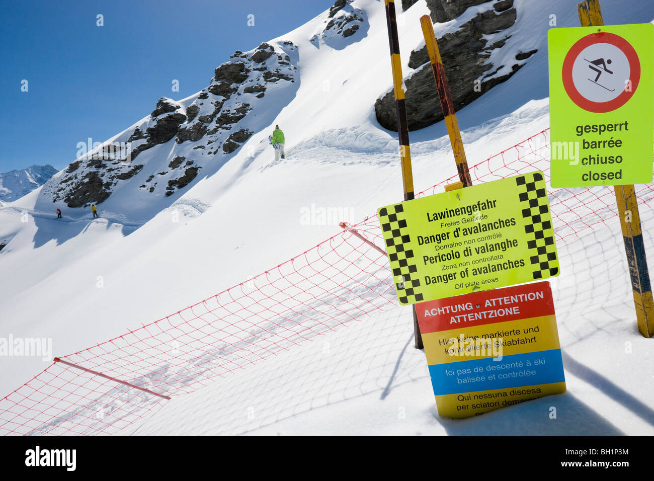 Domaine de Freeride, Zinal, barriers and avalanche warning signs, canton Valais, Wallis, Switzerland, Alps, MR - Stock Image