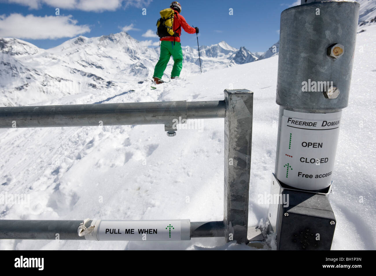 Domaine de Freeride, Zinal, A young man on skis passes an avalanche security gate, canton Valais, Wallis, Switzerland, - Stock Image
