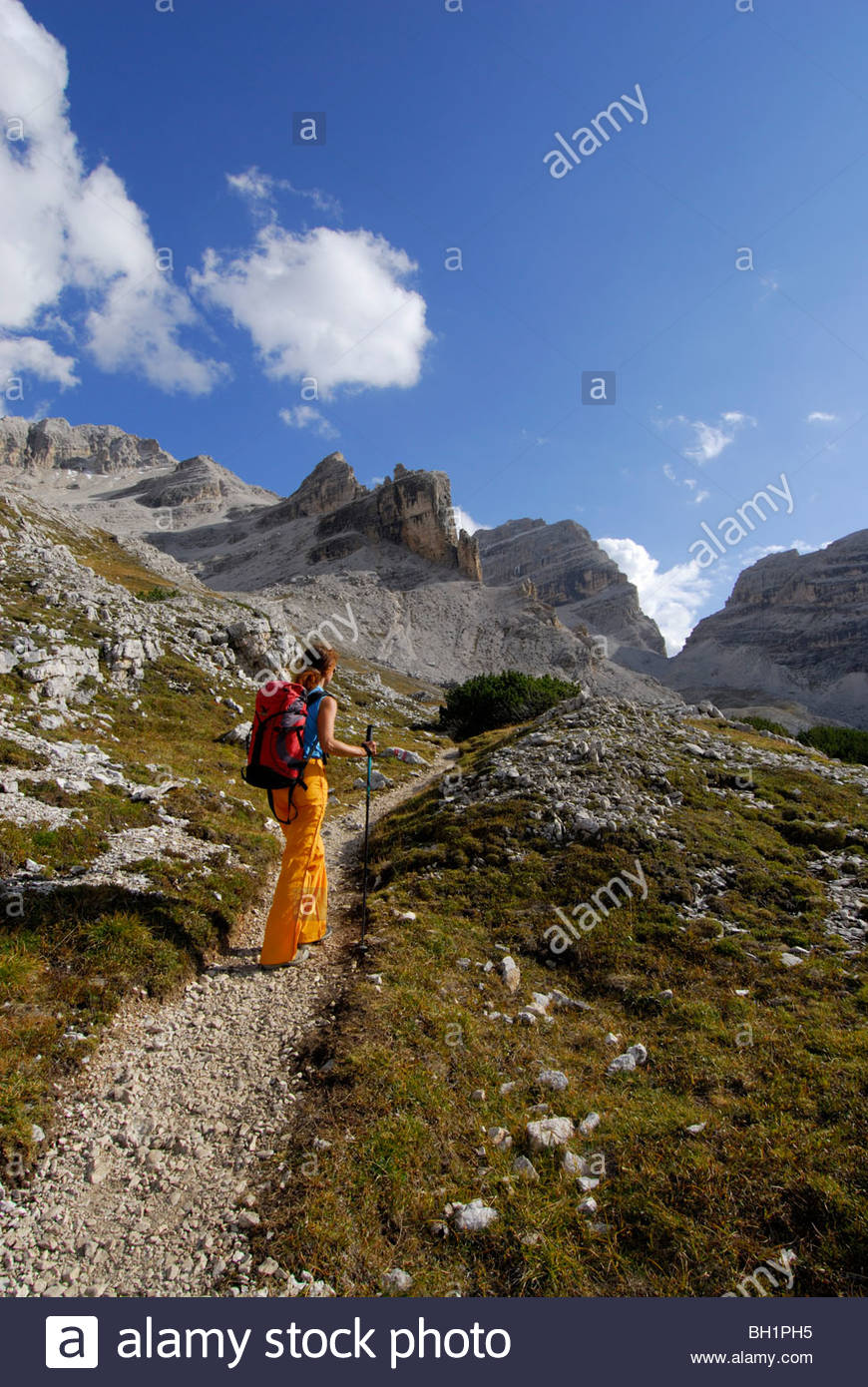 Young woman ascending Forcella di Lech, Alta Via delle Dolomiti No. 1, Parco Naturale Fanes-Sennes, Dolomites, South - Stock Image