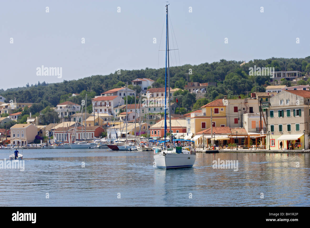 A boat leaving Gaios harbour, Paxos, Ionian Islands, Greece - Stock Image