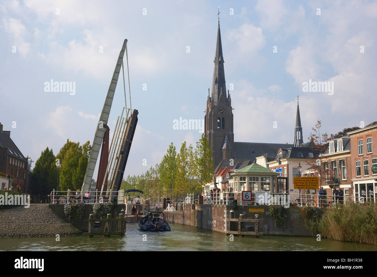 A boat driving past a bascule bridge on the river Smal Weesp at Weesp, Netherlands, Europe - Stock Image