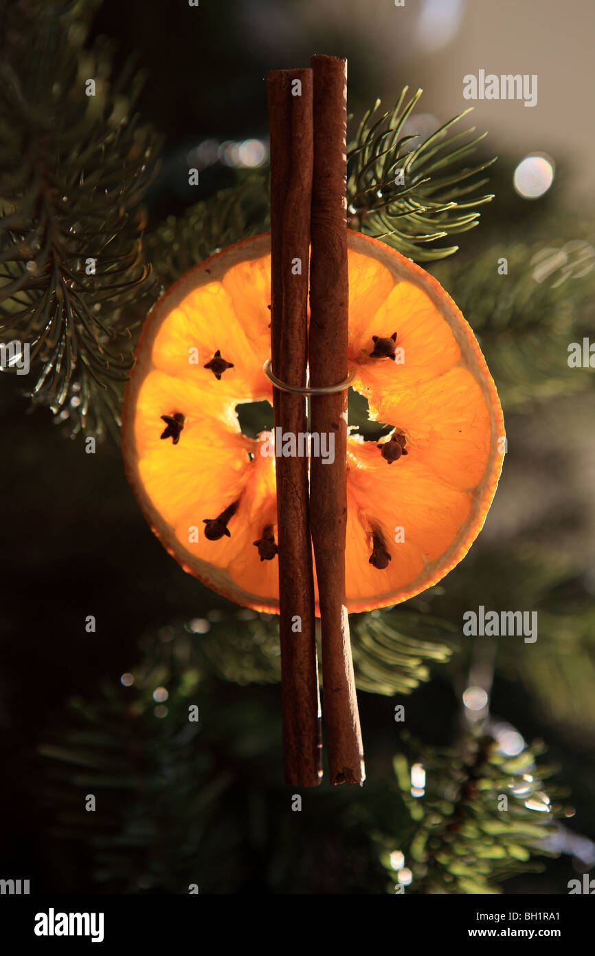 homemade christmas tree decoration of dried orange cinnamon sticks and cloves stock image - Orange Christmas Decorations