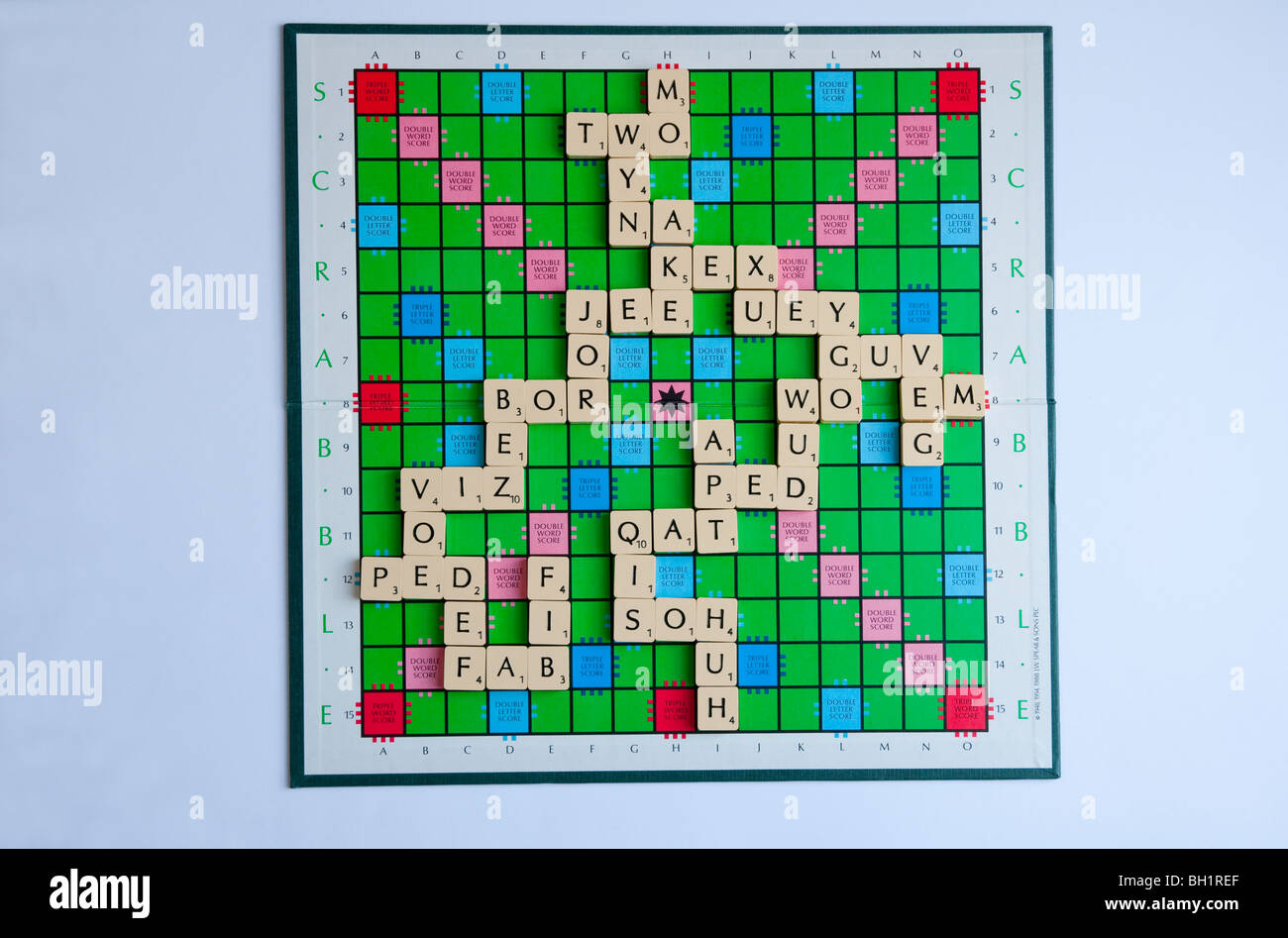 A Scrabble board, showing a variety of two and three letter words; crucial to learn if you are serious about winning - Stock Image