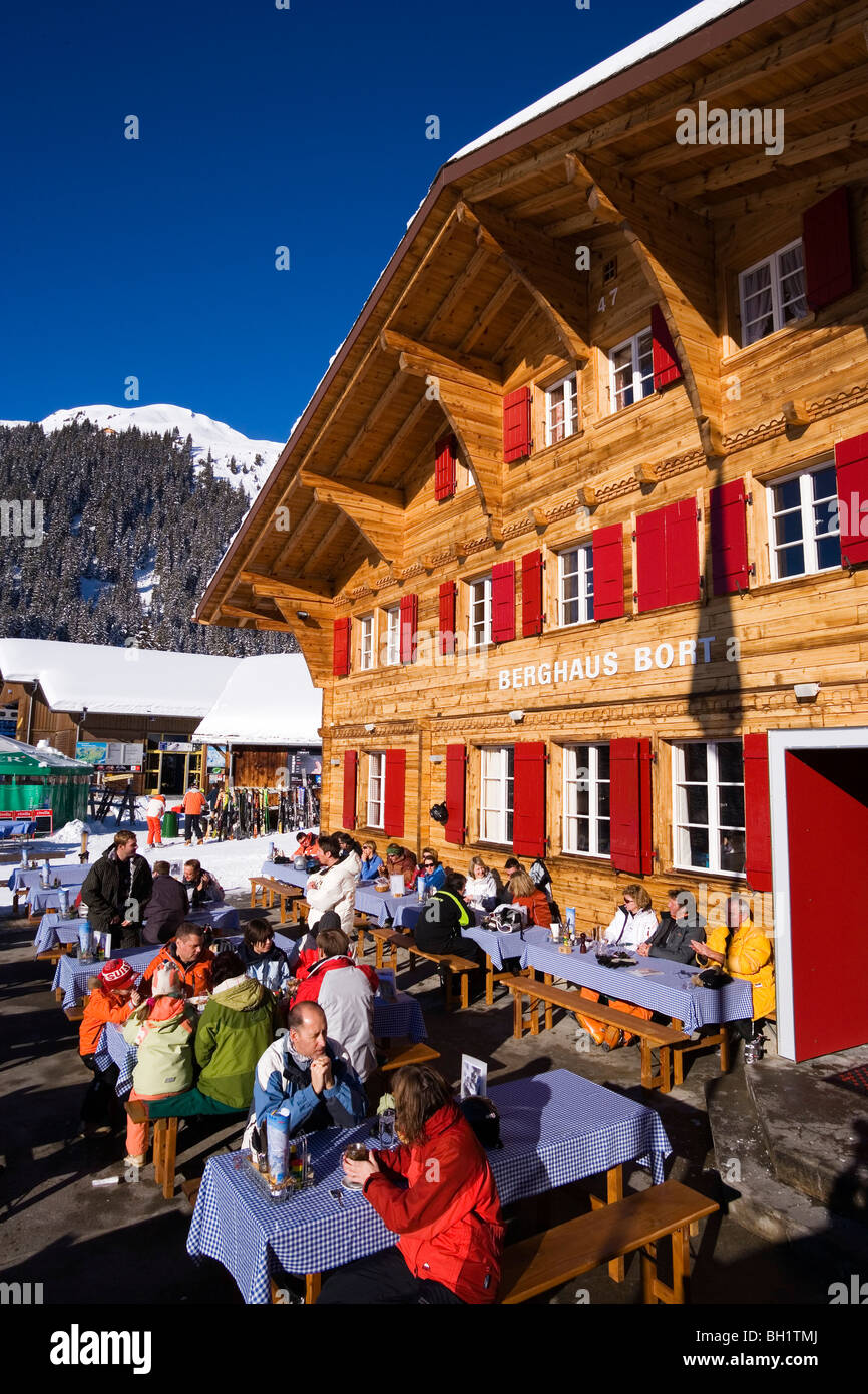 Guests resting on terrace of the mountain restaurant Bort, First, Grindelwald, Bernese Oberland, Canton of Bern, - Stock Image
