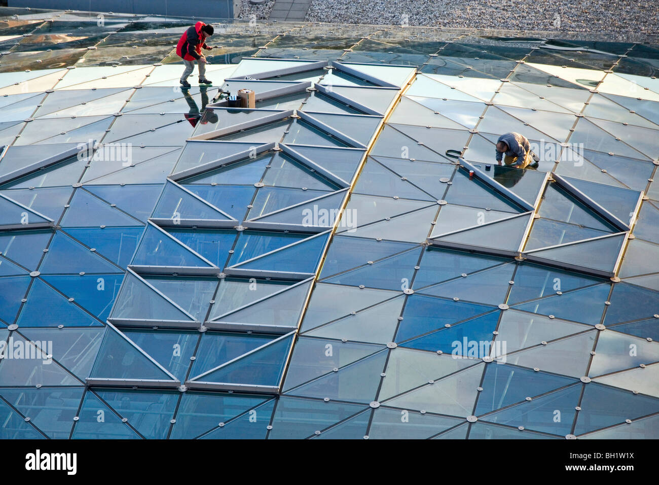 repairing glass roof, Potsdam Platz, Berlin Germany - Stock Image