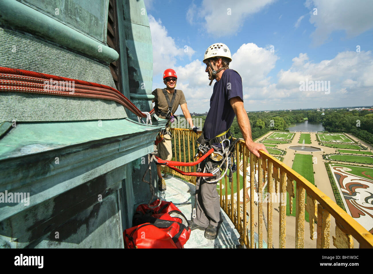 industrial climbers working on dome of Charlottenburg Palace, Berlin, Germany - Stock Image