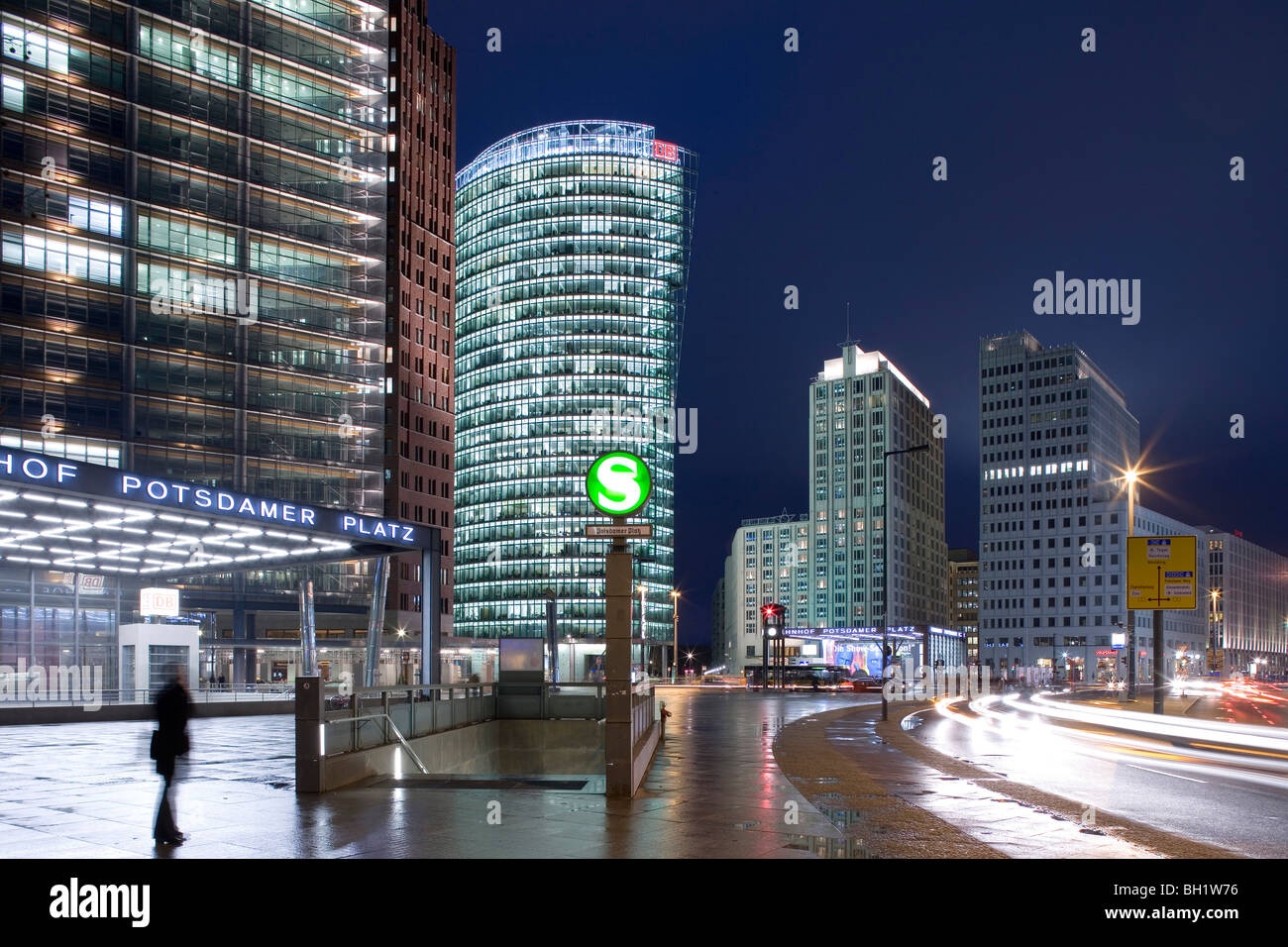 Potsdamer Platz at night from left to right, Renzo Piano Tower, Hans Kollhoff Tower, Bahn Tower, Beisheim Center, - Stock Image