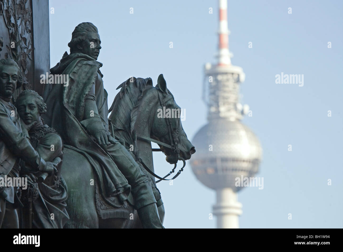 equestrian statue, memorial, Alter Fritz, Frederik the Great, with the Alex Television tower, Berlin Germany - Stock Image