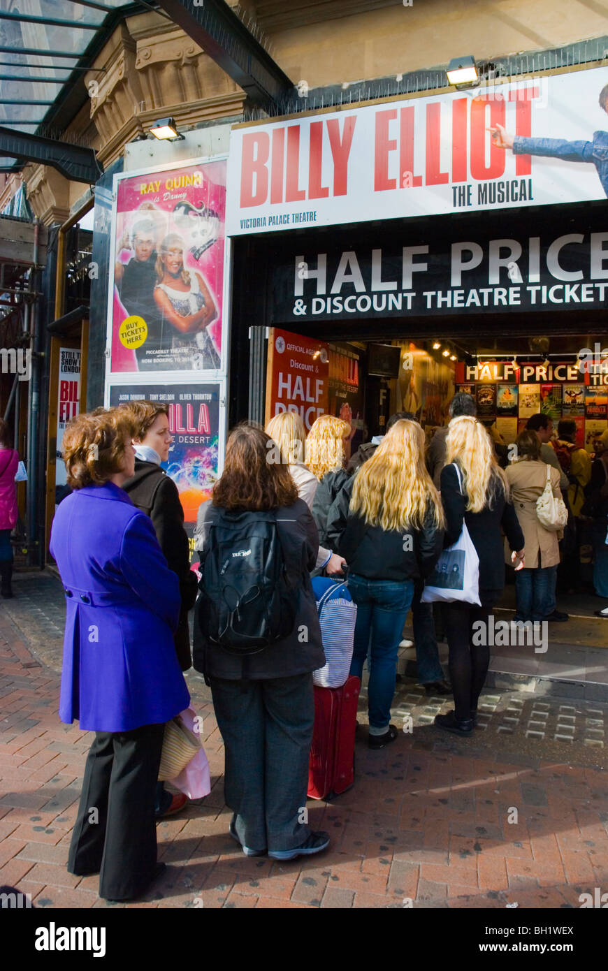 Queue to discount theatre ticket counter Leicester Square central London England UK - Stock Image