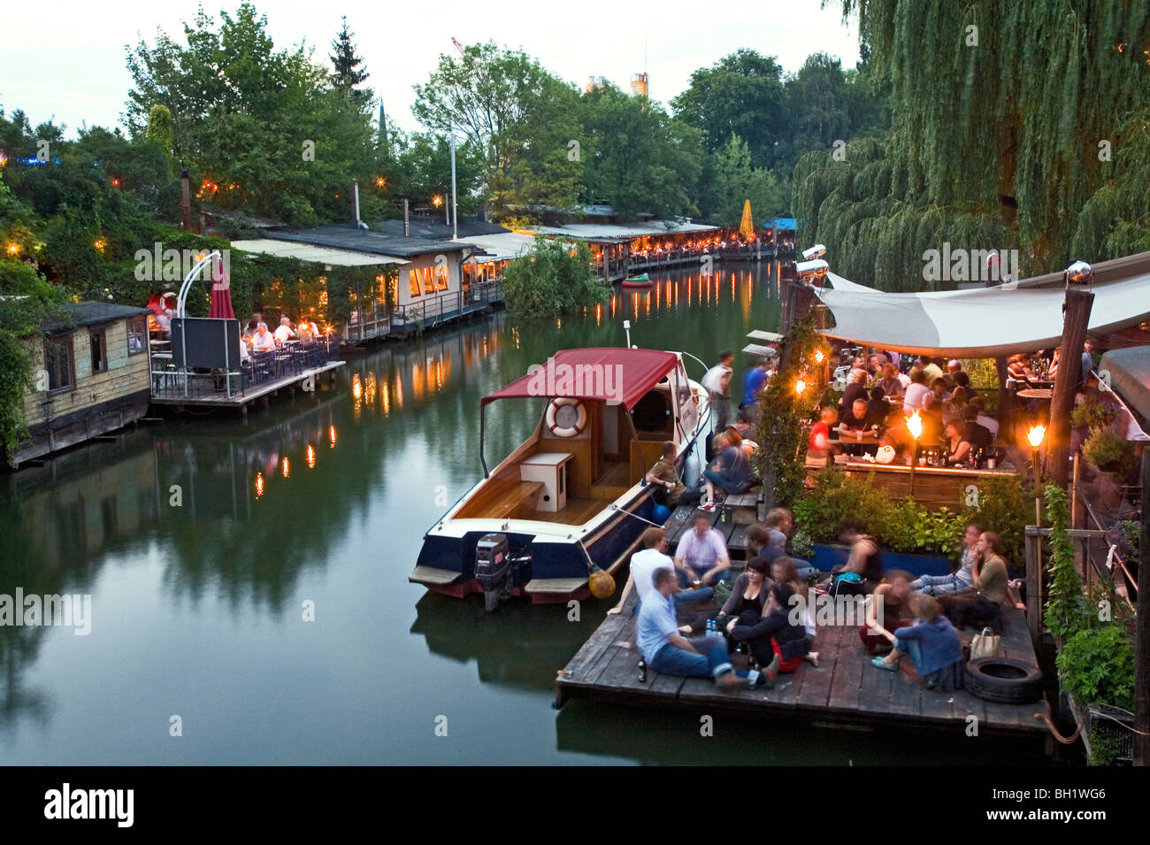 Club der Visionaere, restaurants, cafés, bars at Flutgraben in the evening, canal, Treptow, Berlin, Germany - Stock Image