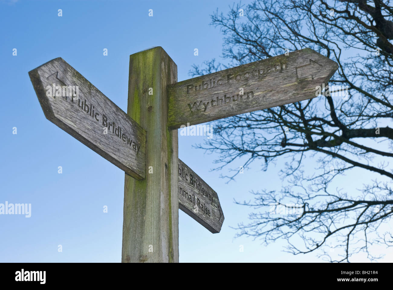 Wooden public footpath and bridleway sign in the Lake District, Cumbria - Stock Image