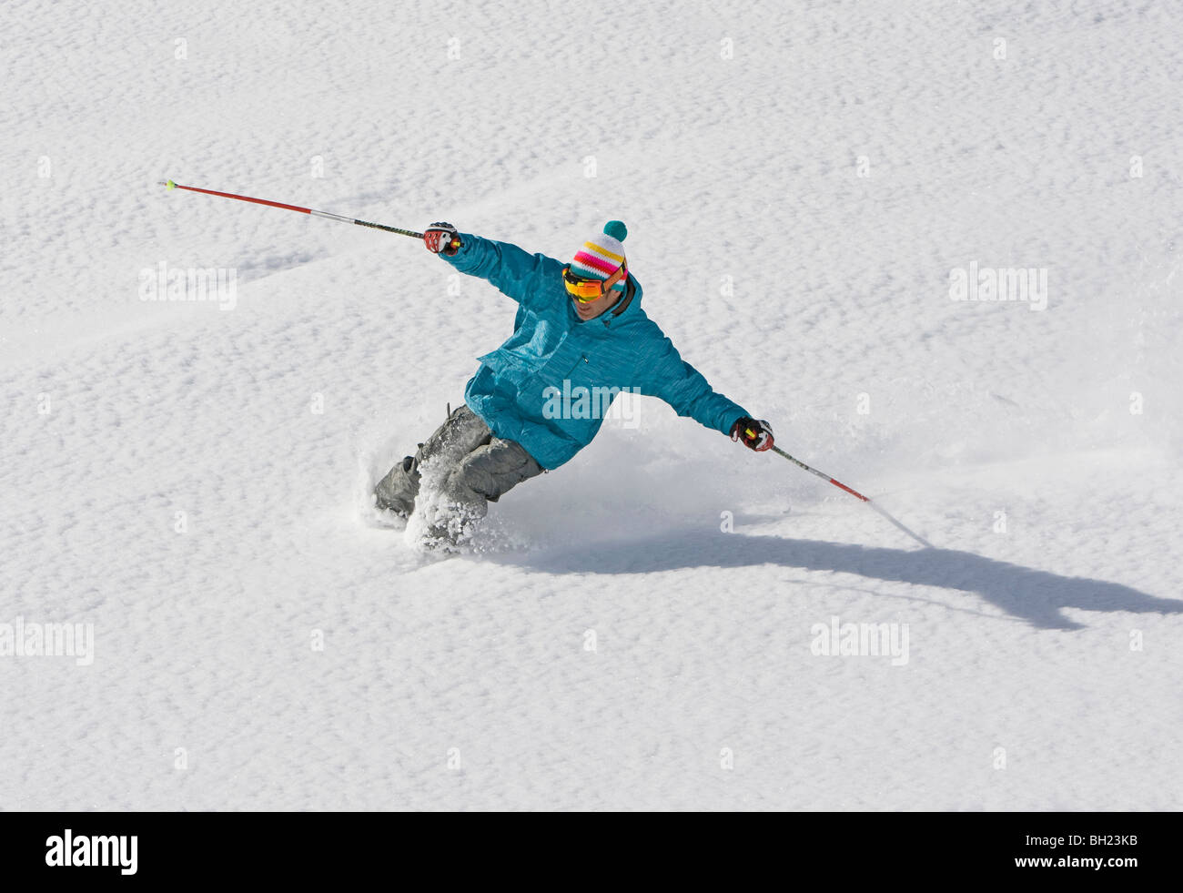 Professional male skier jumps into powder snow, off-piste Val d'Isere - Stock Image