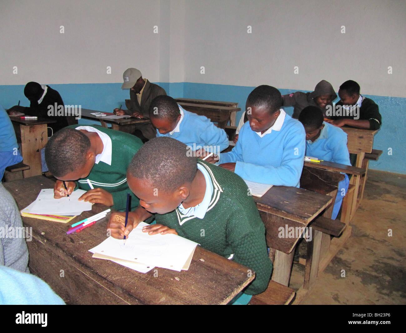 African school children working Kilema Moshi Tanzania East Africa Stock Photo