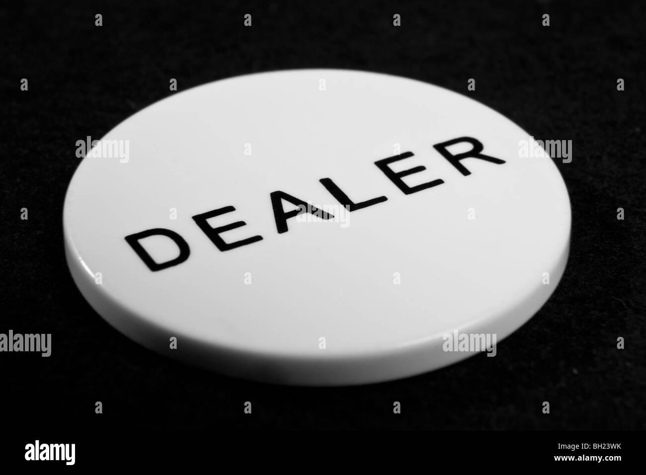 dealer chip from poker - Stock Image