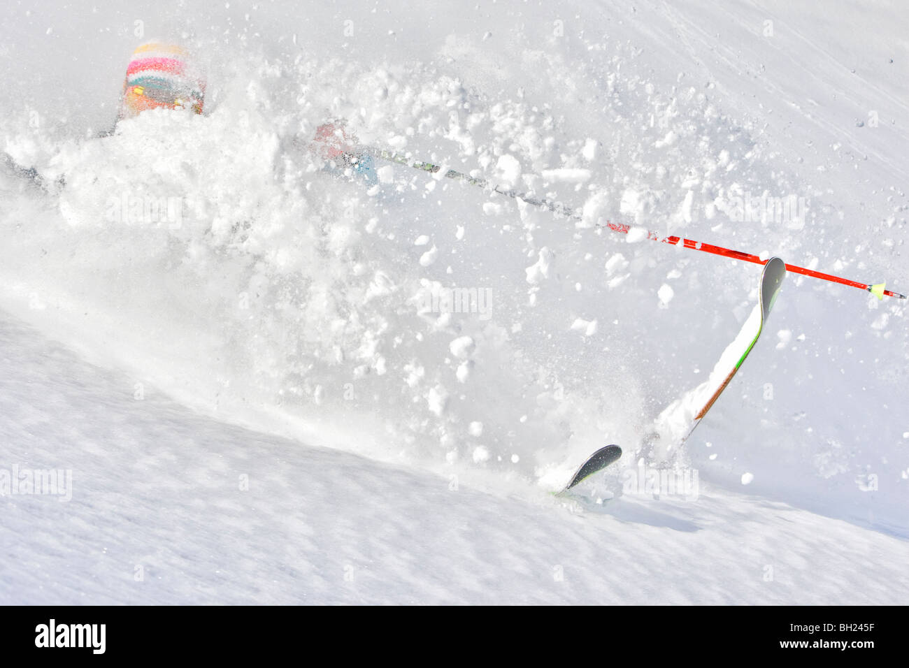 Male skier turning in deep powder snow, off piste Val d'Isere - Stock Image
