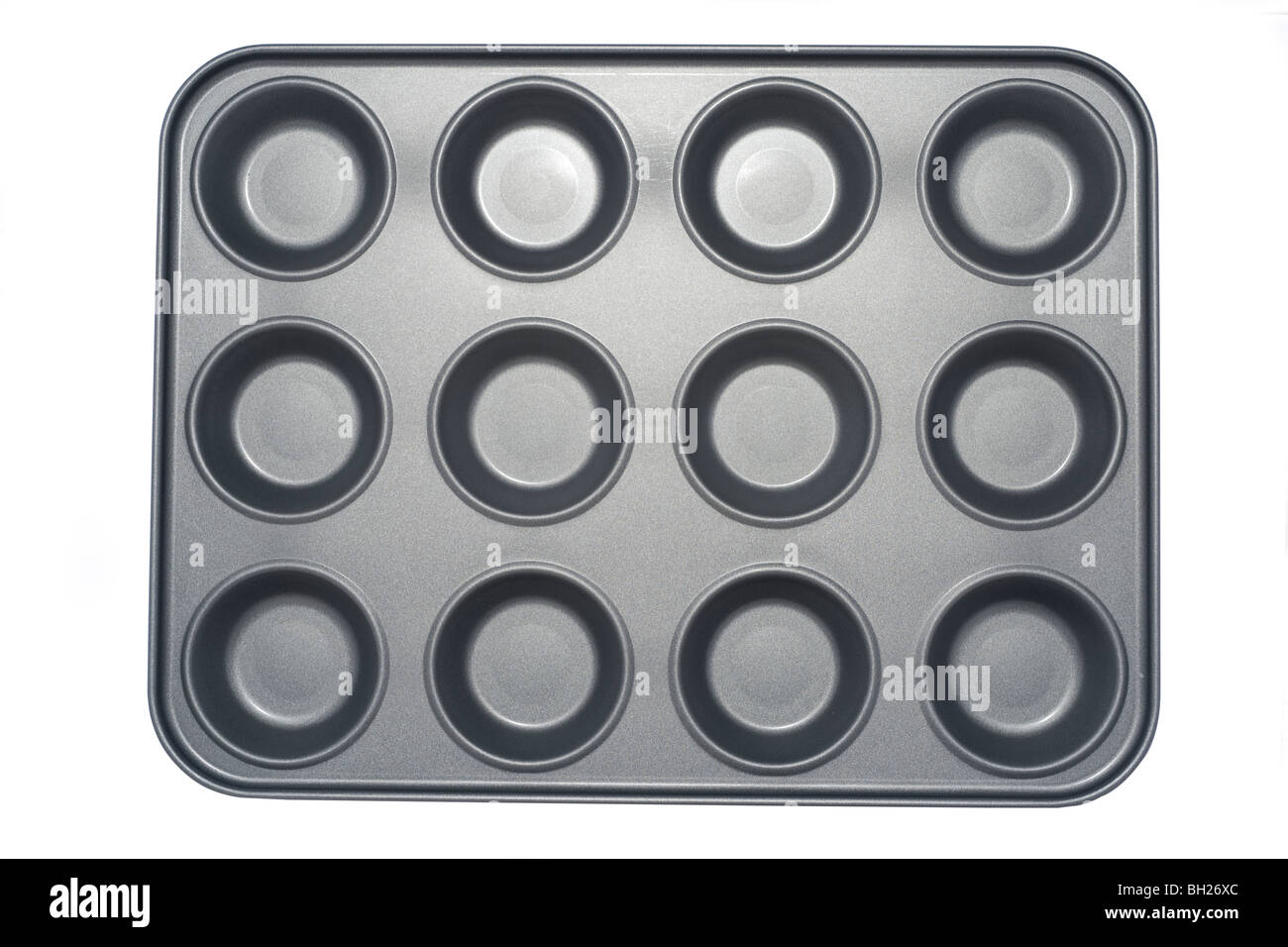 Twelve sectioned grey metal teflon coated muffin tray - Stock Image