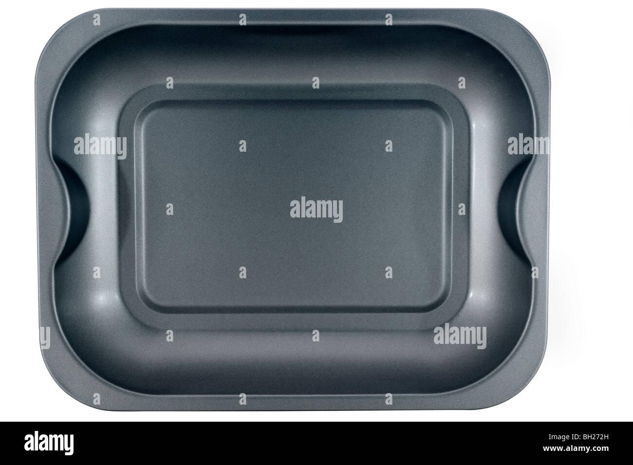 Grey teflon coated metal baking tray - Stock Image