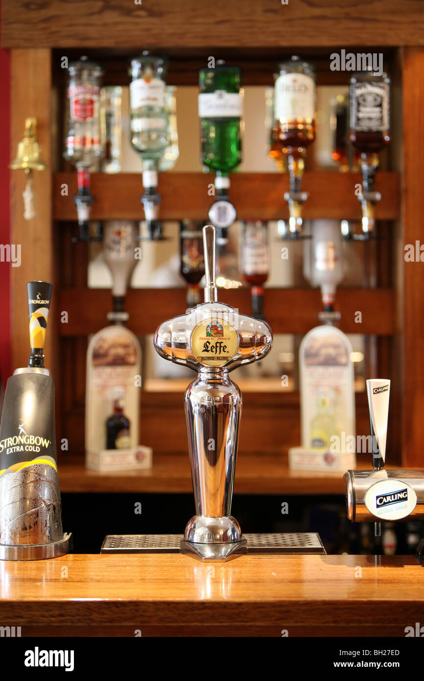 Pub bar - Beer pumps and spirit optics - Stock Image