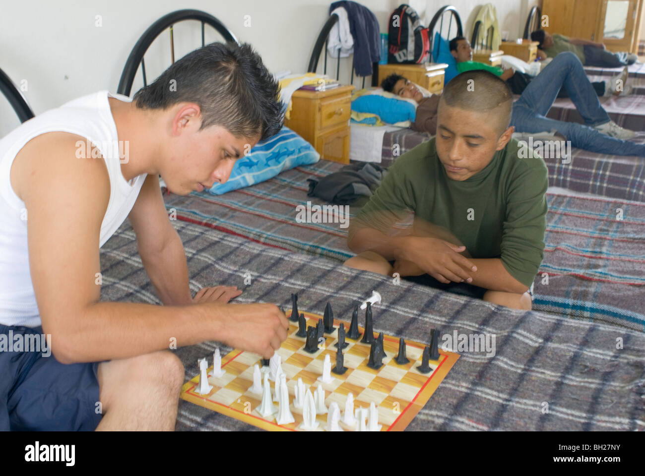 At the municipally-run Addiction Treatment Center in Ciudad Nezahualcóyotl, resident addicts play chess. - Stock Image