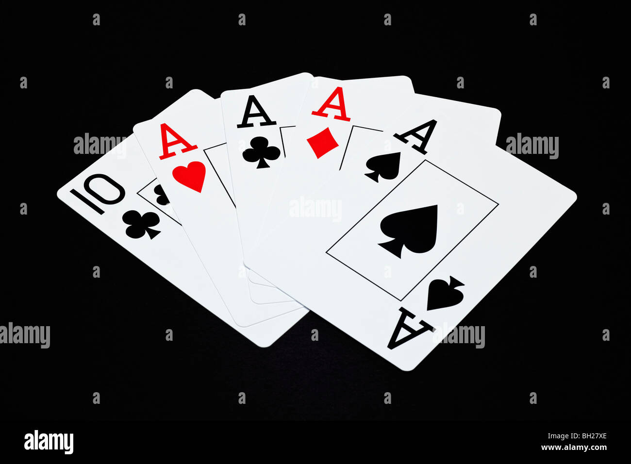 Playing cards showing a Four of a Kind poker hand with aces - Stock Image