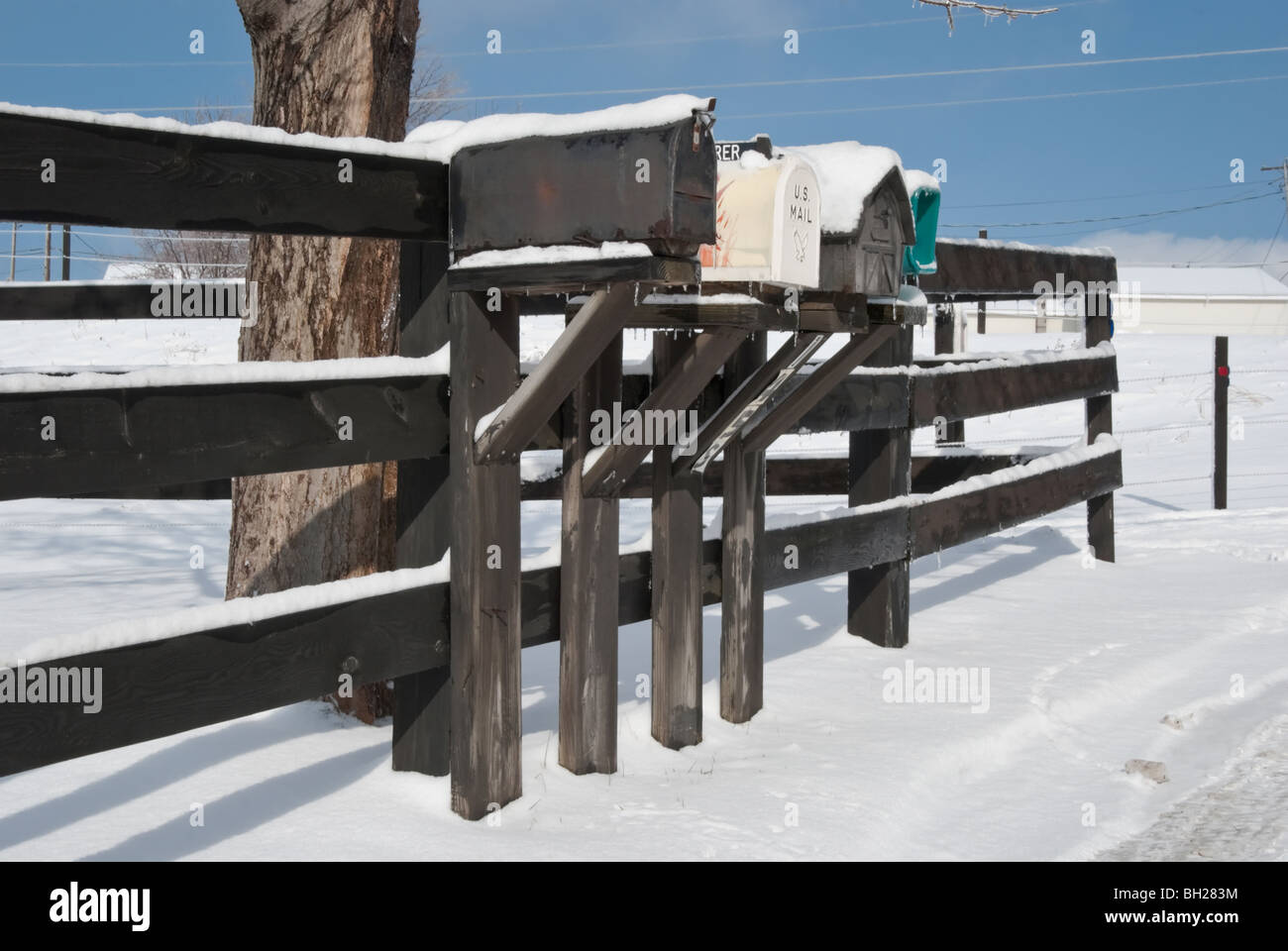 Rural delivery mailboxes in winter snow and ice after a storm. Stock Photo