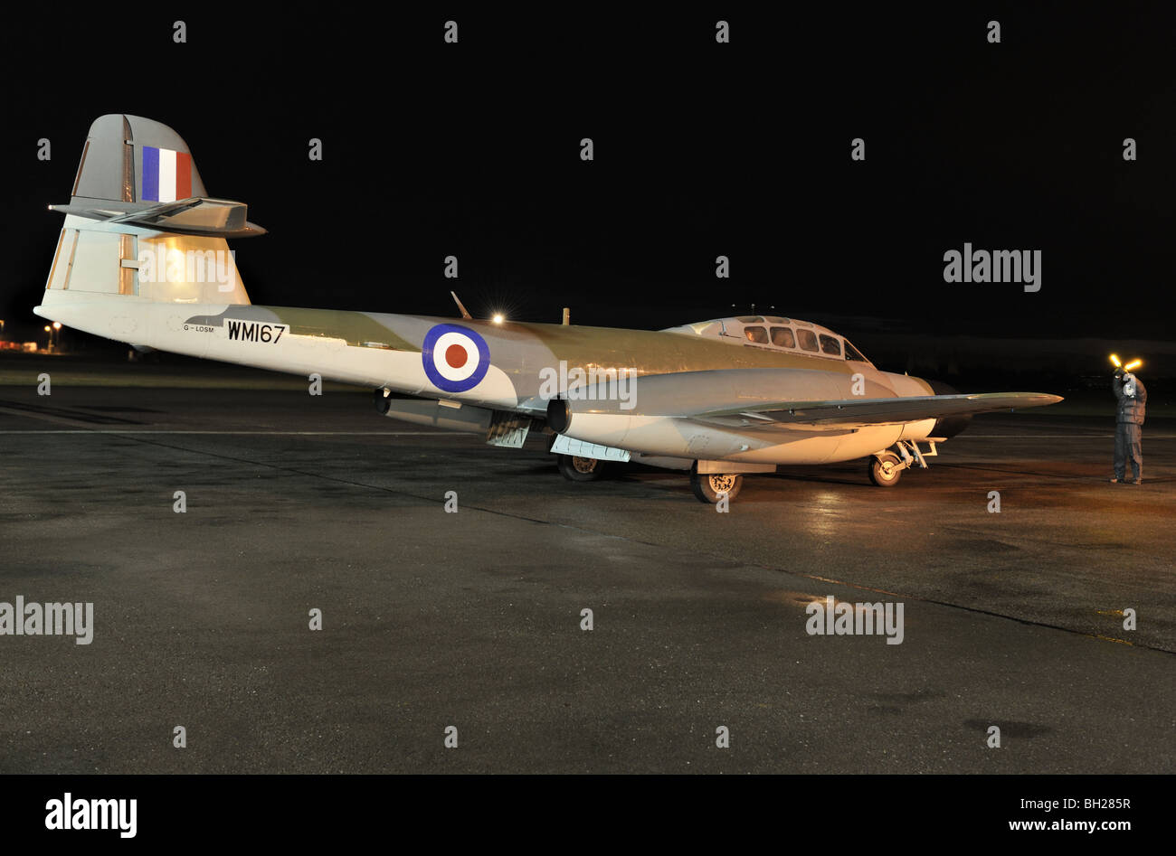 Vintage RAF Meteor two seat jet training aircraft taxying in the dark during a vintage display at Coventry Airport, - Stock Image