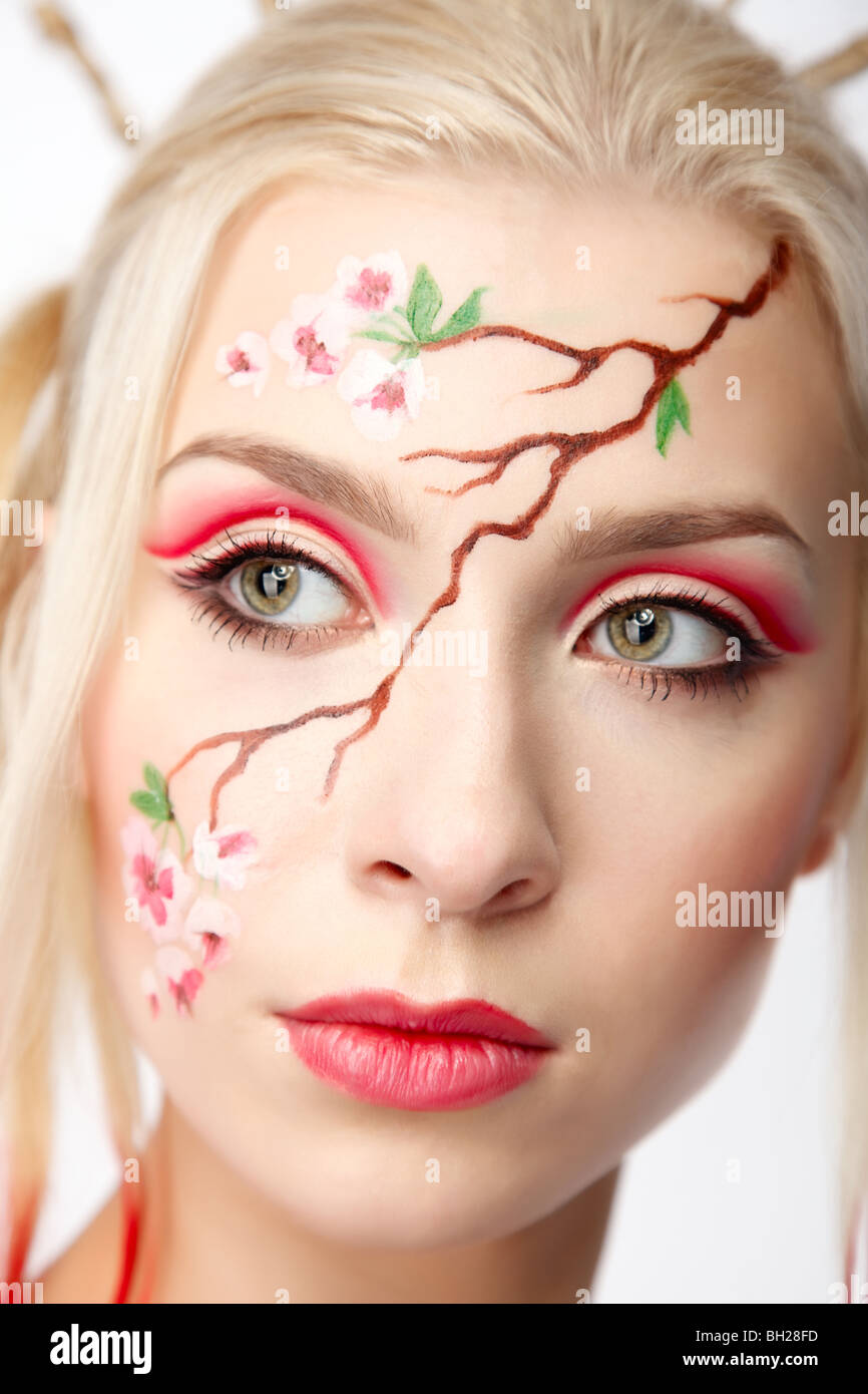 Blonde girl in the 'Sakura' image, artistic bodyart - Stock Image