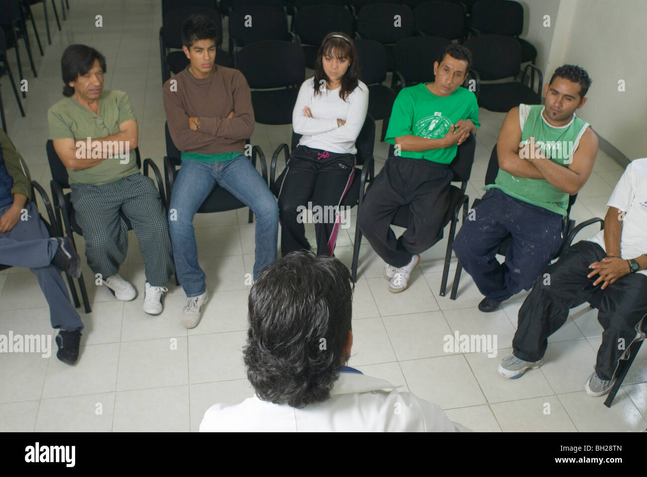 At the municipally-run Addiction Treatment Center in Ciudad Nezahualcóyotl, addicts engage in group therapy. - Stock Image