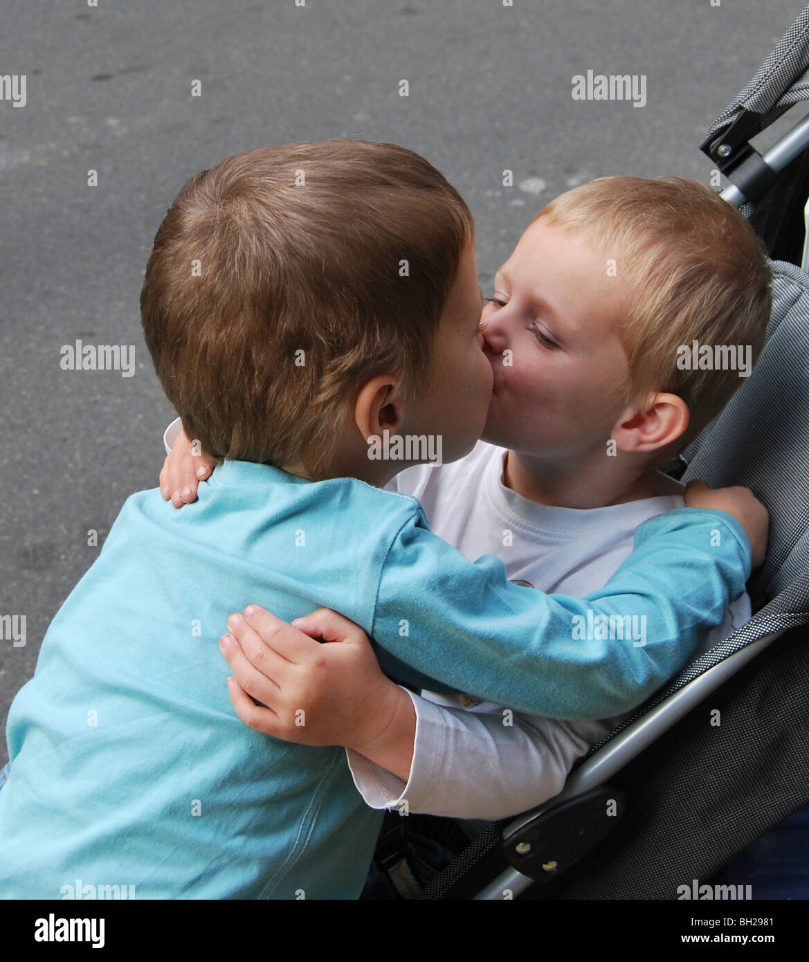 Brotherly love, 2 brothers sharing a kiss - Stock Image