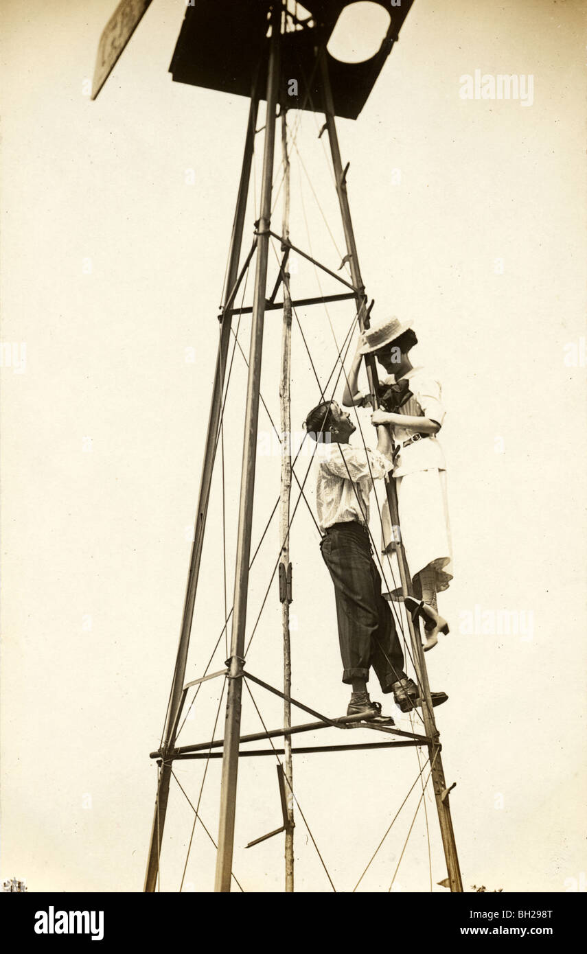 Daredevil Couple Standing on Windmill - Stock Image