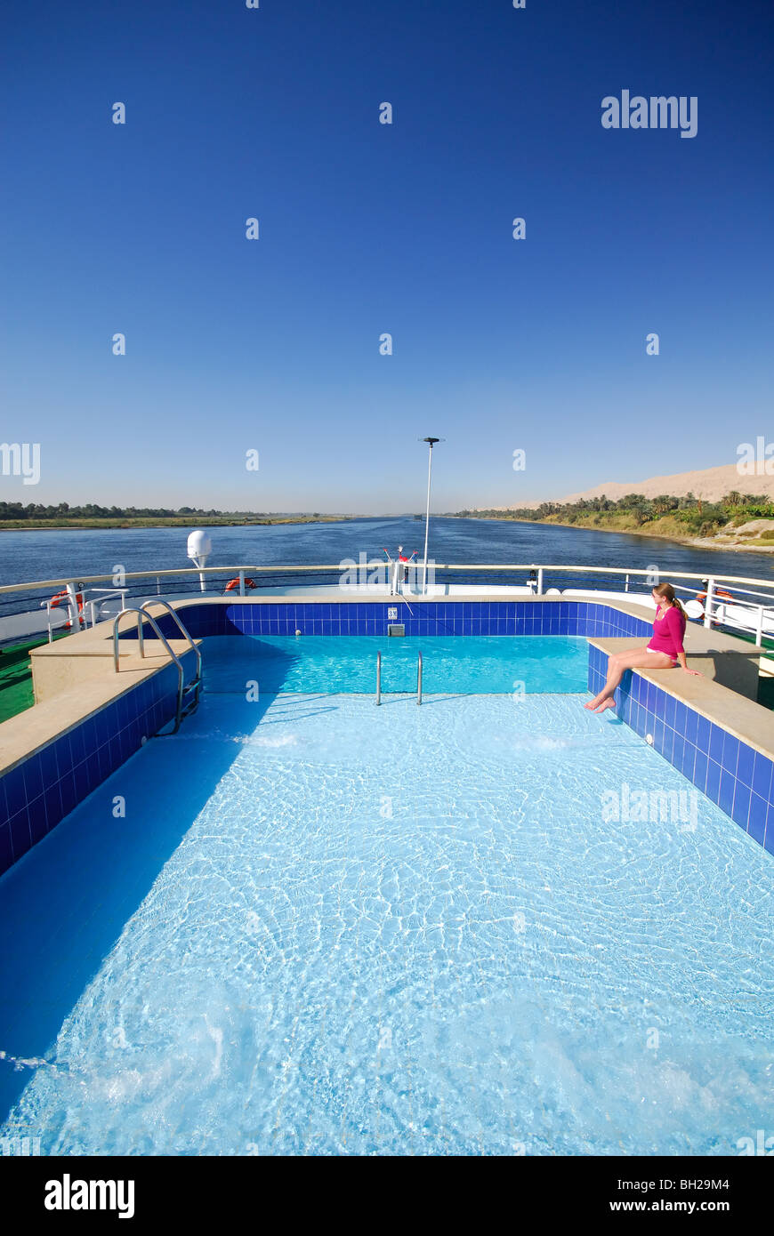 RIVER NILE, UPPER EGYPT. Swimming pool on a Nile cruise boat sailing between Luxor and Aswan. Stock Photo