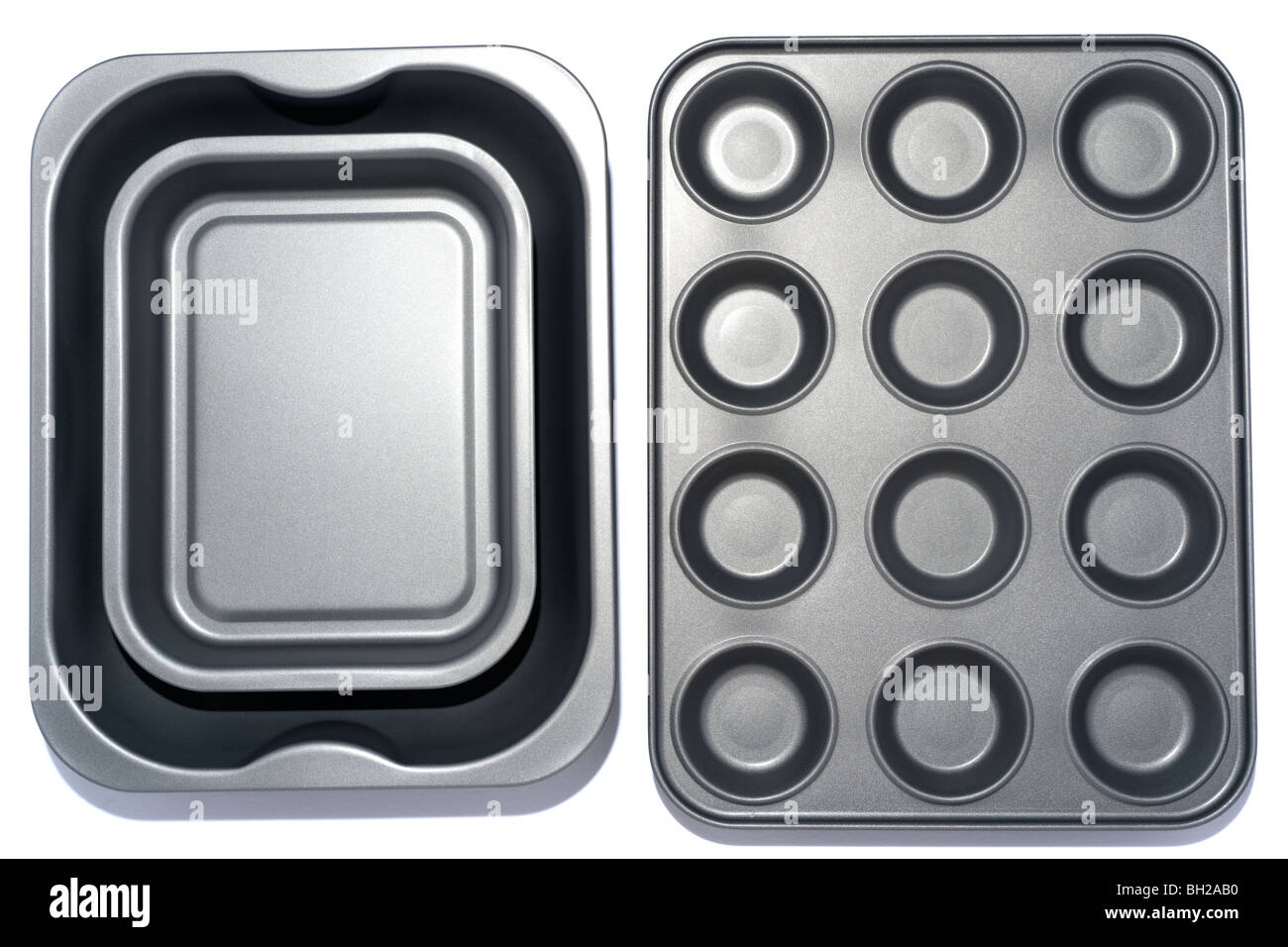 Two grey teflon coated metal baking trays - Stock Image