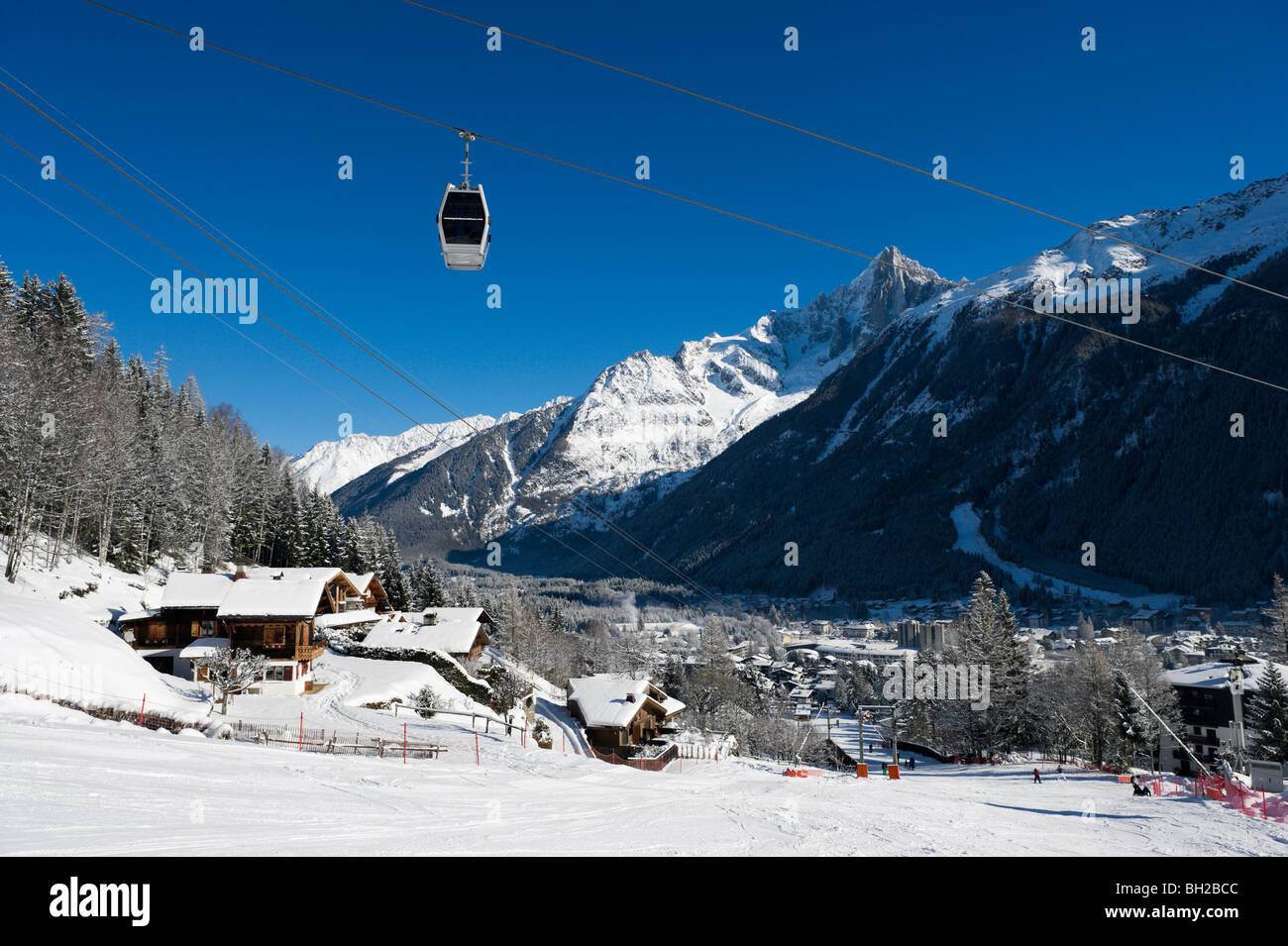 View over the resort from the nursery slopes by Le Brevent lift, Chamonix Mont Blanc, Haute Savoie, France - Stock Image