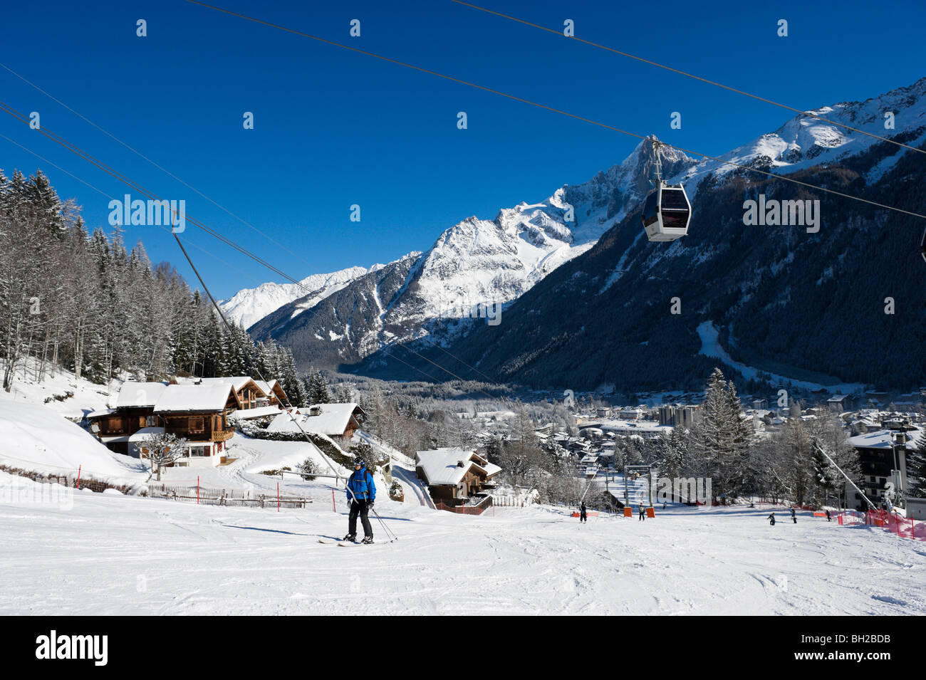 View over the resort & the drag lift on the nursery slopes by Le Brevent gondola, Chamonix Mont Blanc, Haute - Stock Image