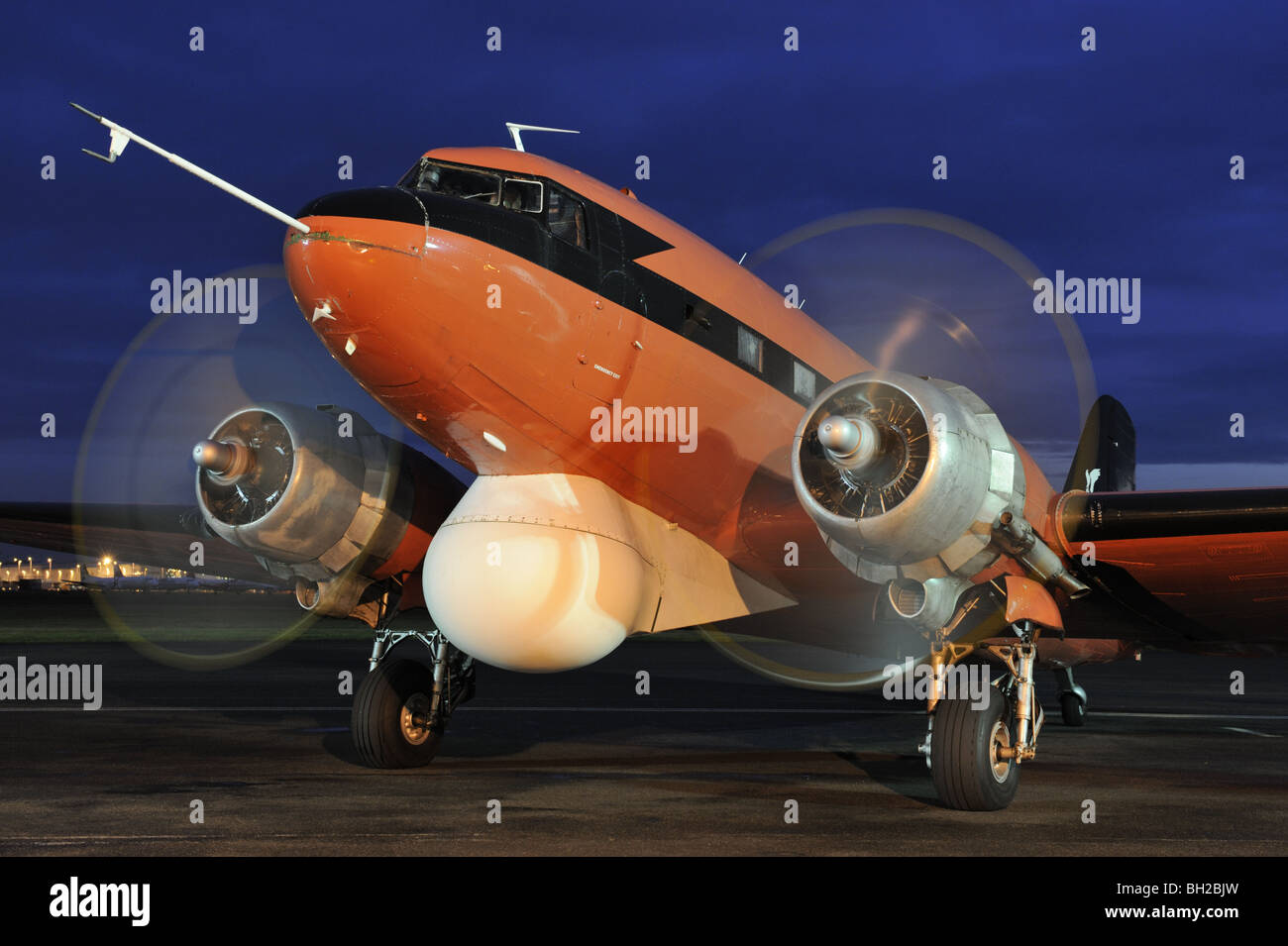Vintage Douglas DC 3 Dakota aircraft taxying in the dark during a vintage display at Coventry Airport, UK. - Stock Image