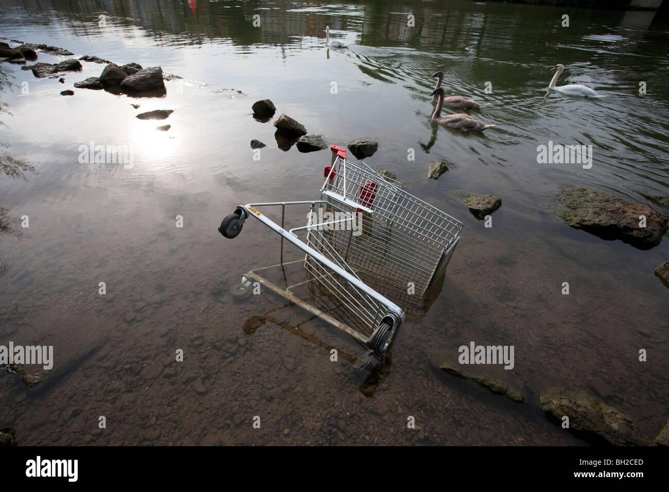 SHOPPING CART IN RIVER NECKAR, STUTTGART, BADEN WUERTTEMBERG, GERMANY - Stock Image