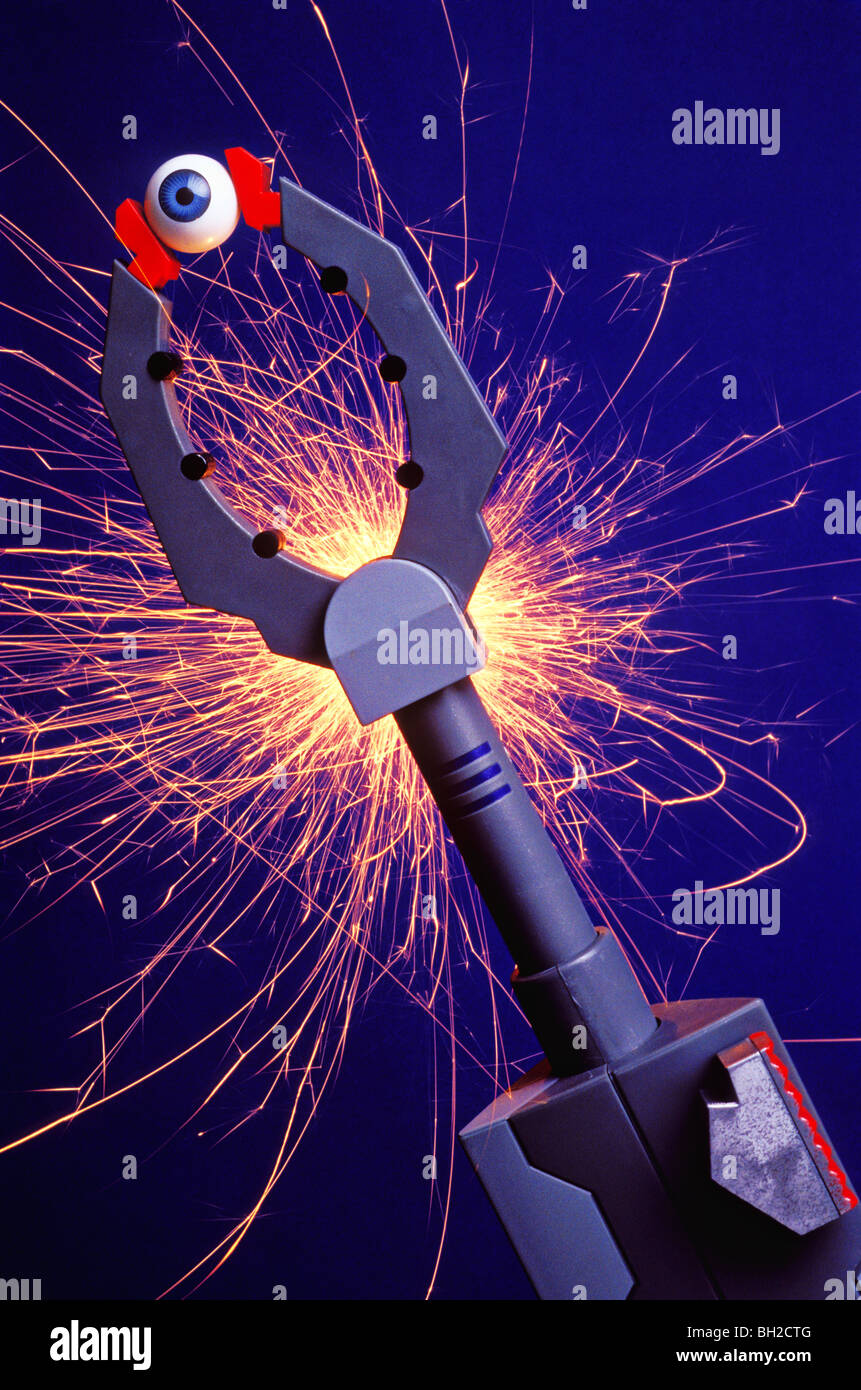 Robotic arm holding eyeball with sparks - Stock Image