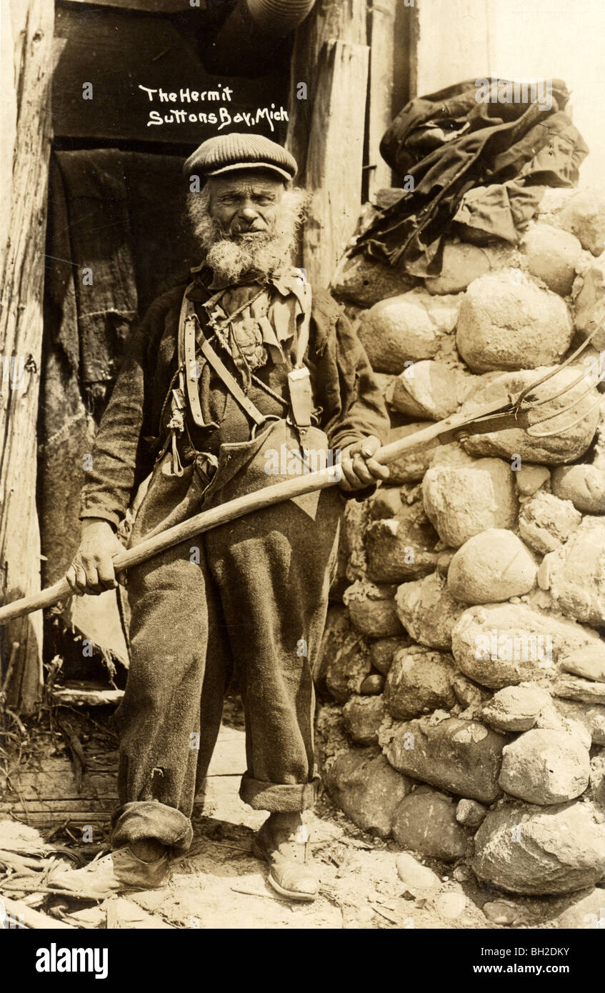 Deformed Hermit Armed with Pitchfork - Stock Image